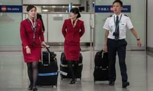 Cathay Pacific staff at Hong Kong international airport.