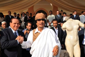 2008: Berlusconi shakes hands with the then Libyan leader Muammar Gaddafi during their meeting in Benghazi. Italy and Libya signed an accord under which Italy would pay billions of dollars in compensation and investments for colonial misdeeds during its decades-long rule of the north African country. In a goodwill gesture, Italy returned an ancient statue of Venus taken to Rome during colonial rule