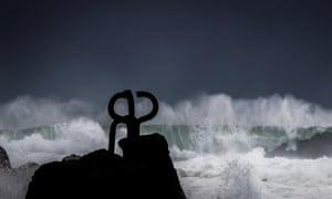 Waves crash against Eduardo Chillida's sculpture Peine del Viento (The Wind's Comb) in San Sebastián, Spain