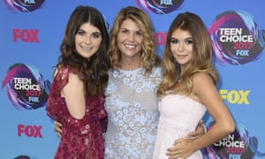 Family affair: Lori Loughlin, poses with her daughters Bella, left, and Olivia Jade at the Teen Choice Awards in Los Angeles.