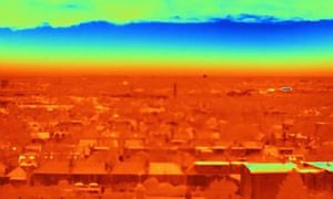 A thermal image of London rooftops indicates heat loss through roofs.