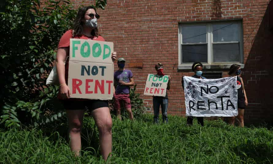 People gather outside an apartment complex with the intention to stop the alleged eviction of one of the tenants in Mount Rainier, Maryland, on Monday.