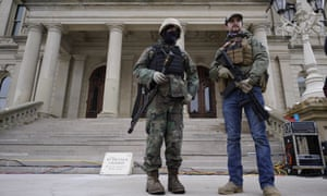 Armed men stand at the Michigan Capitol after a pro-Trump rally on Wednesday.