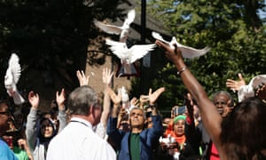The mayor of London, Sadiq Khan, centre, takes part in a release of doves as a show of respect for those who died in the Grenfell Tower fire, during the Notting Hill carnival