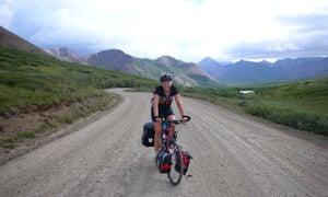 Anna McNuff riding through Denali National Park, Alaska.