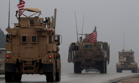 In a picture from December 2018, US military vehicles are seen in Syria's northern city of Manbij.