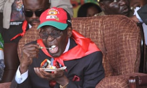 Mugabe eats cake during celebrations for his 88th birthday in 2012.