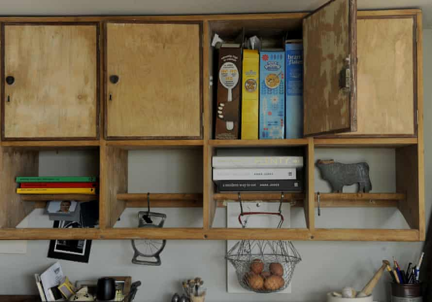 cupboards storing cereal and books