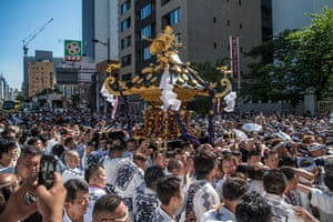 Participants carry a mikoshi (portable shrine) near Asakusa Temple