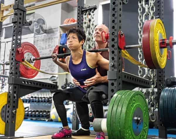 Pam Li, with her own trainer Matt Nicholson, preparing for the powerlifting word championships.