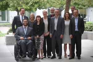 The Greens pose for a group photograph in the Senate courtyard of Parliament House in Canberra this morning