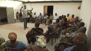 Ezekiel addressing a town meeting in Aboano, Ghana