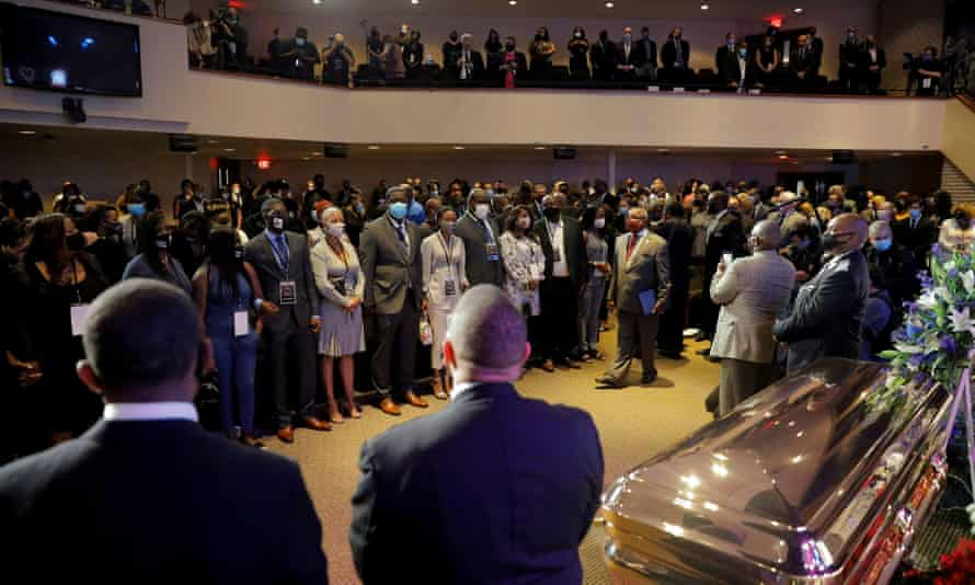 People attend a memorial service for George Floyd following his death in Minneapolis police custody.