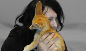Anohni with a fennec fox at Bronx zoo orphanage.