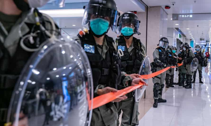 Riot police at a Hong Kong shopping centre during a 'Sing With You' rally on Tuesday.