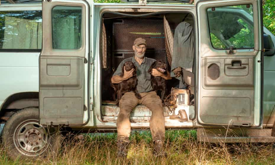 John Rucker, a turtle hunter from Montana, with his dogs in the Sherwood Forest community in Brevard, North Carolina.