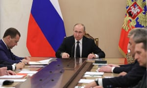 Russia's President Vladimir Putin (centre) and Russia's Prime Minister Dmitry Medvedev (left) during a meeting of the Russian security council in the Kremlin.