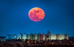 The second full moon rises in the sky over Hull, UK