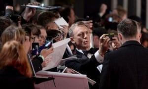 Daniel Craig takes a selfie with a fan