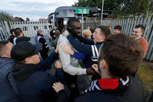 Ousseynou Cisse of MK Dons is encouraged by away fans after he got off the team bus.