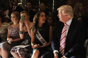 Miss USA 2013, Olivia Culpo, and Trump attend New York fashion week at the Trump Tower grand corridor