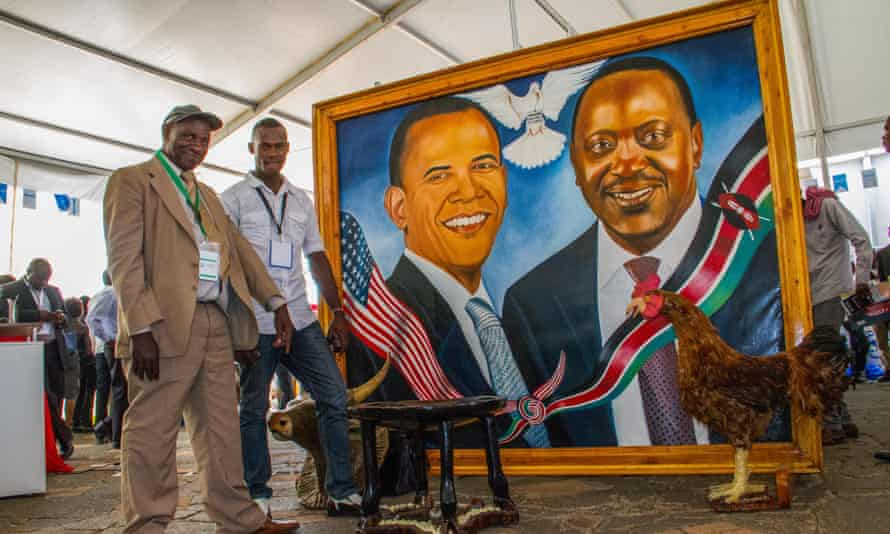 A portrait of US president Barack Obama and his Kenyan counterpart Uhuru Kenyatta painted by Joackim Ndalo (right) and his son Dominic (left) .