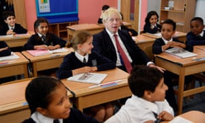 Boris Johnson attends a class during his visit to Pimlico primary school in London this afternoon.