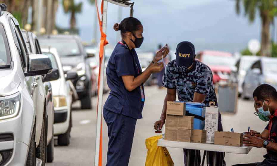 A health worker prepares a dose of the AstraZeneca vaccine at a drive-through vaccination centre in Suva, Fiji