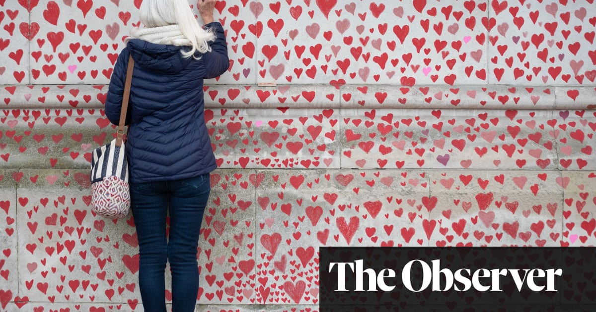 Wall of hearts grows as a memorial to loved ones taken by coronavirus