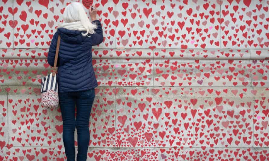 Volunteers draw a heart for each victim on the wall outside St Thomas' Hospital opposite Houses Of Parliament.