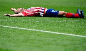 Atlético Madrid's Uruguayan defender Diego Godín celebrates scoring.