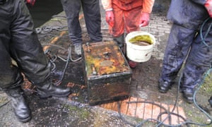Volunteers in Birmingham with their haul from canal cleanups, including a safe