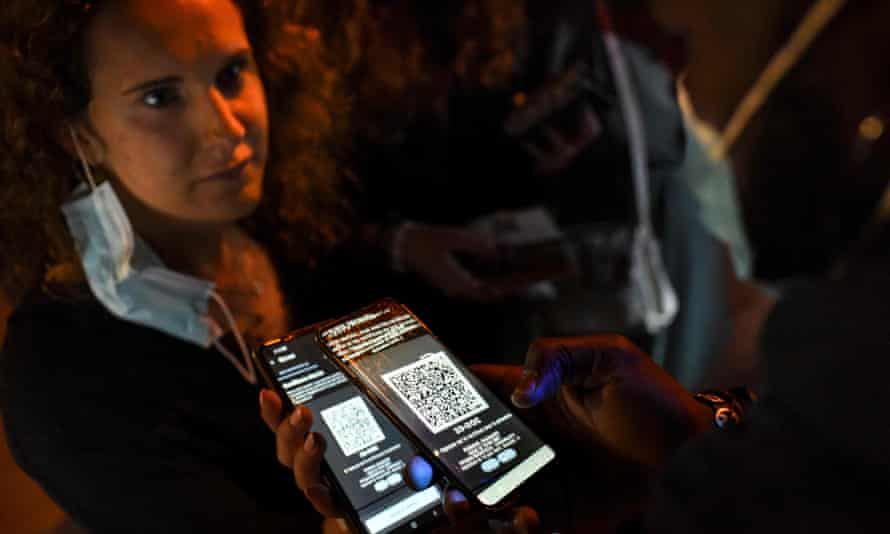 Checking phone at door to nightclub