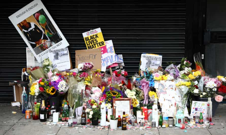 Floral tributes outside the shop where Rashan Charles was arrested in Dalston, east London.