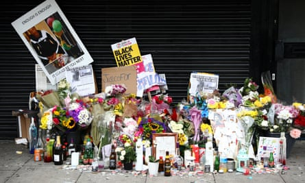 Tributes to Rashan Charles left outside a shop in east London