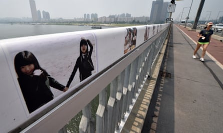 Images are displayed along a bridge in Seoul in an attempt to dissuade potential suicides.
