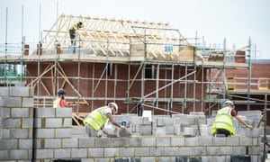 UK builders constructing a house