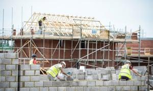 Builders building homes