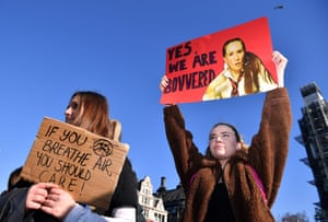 Young demonstrators hold placards as they attend a climate change protest organised by Youth Strike 4 Climate opposite the Houses of Parliament in central London
