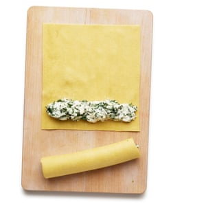 Lay a log of the spinach mix on the bottom of each lasagne sheet, then roll up like a cigar and trim the ends.