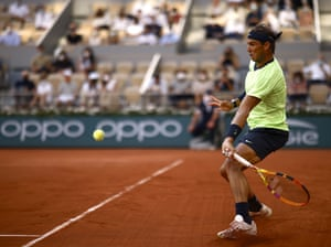 Rafael Nadal fires a forehand to Novak Djokovic.