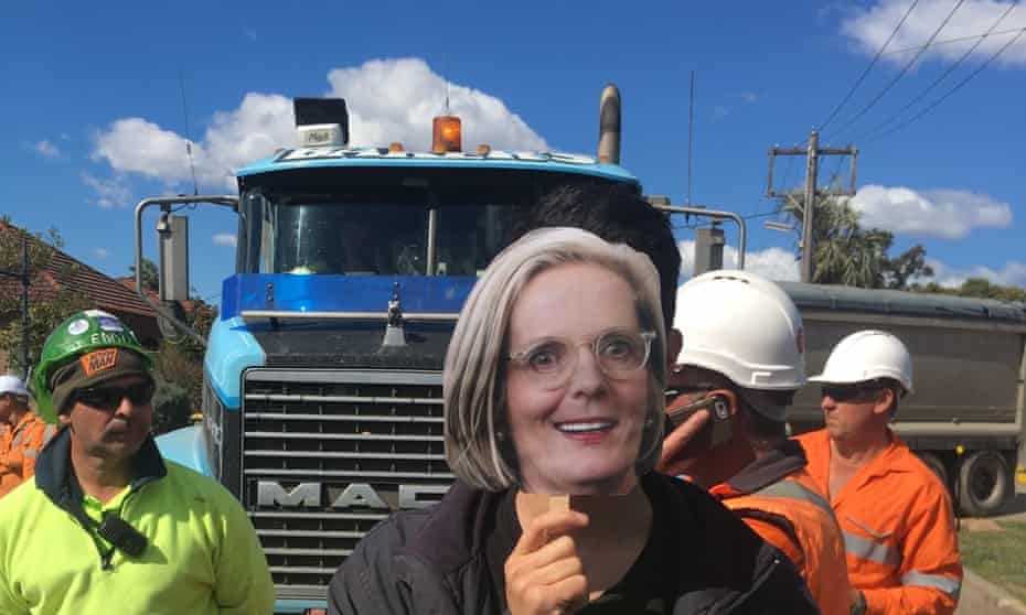A protester with the Stop WestConnex campaign wears a mask of Australian prime minister Malcolm Turnbull's wife Lucy's face at a demonstration.