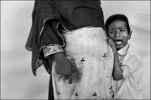 Alfez clings to his grandmother as they arrive at the Chingari Trust clinic for a physical therapy session. Alfez suffers from a range of developmental issues. Doctors believe Alfez has been genetically affected by his father's exposure to the toxic gas.