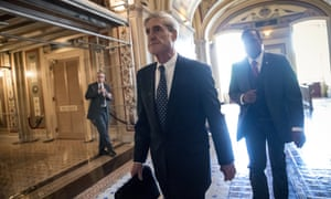 Robert Mueller leaves a meeting with members of the Senate judiciary committee, last June.