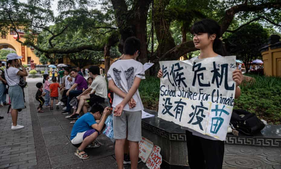 Ou Hongyi, aged 17, stages a protest on a street in Guilin, as the first young person in China to participate in Greta Thunberg-inspired schools climate strikes.