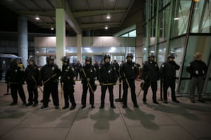Port Authority Police Department block an entrance as protesters gather outside Terminal 4 at JFK airport.
