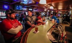 Customers talk and drink at the Somewhere bar in Fond du Lac, Wisconsin.