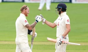 England's Ben Stokes (left) celebrates making his century with fellow century maker Dom Sibley.
