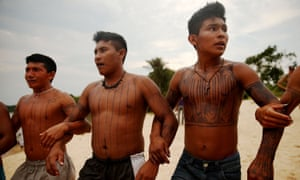Members of the Munduruku tribe dance along the Tapajós river during a protest opposing the now-stopped São Luiz do Tapajós dam in the Amazon rainforest
