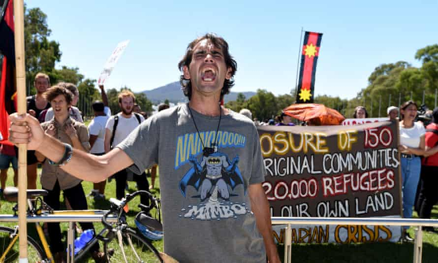 Roxley Foley, son of Aboriginal activist Gary Foley, demonstrates outside Parliament House in Canberra in March 2015 over the Western Australian government's planned closures of remote Aboriginal communities.